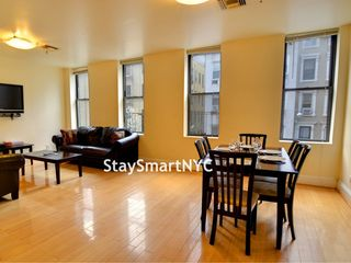 3 BR Apt 3B - Living Room + Dining Area