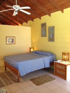 Guest house suite with queen bed, full private bath and high vaulted ceilings