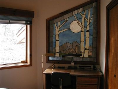 Stained glass window in second bedroom and visible from dining room