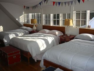 Woodstock house photo - Kids' bunk room with 3 double beds and dressers.