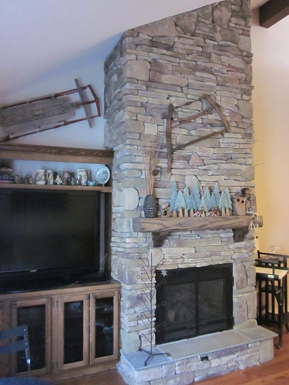 Local artist designed and built stone fireplace