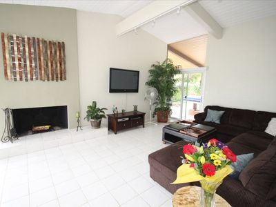 Family room with 50 inch TV and plenty of seating.