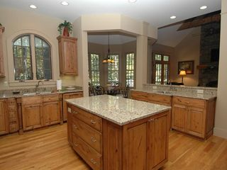 Cashiers estate photo - Spacious Kitchen with Granite Counter Tops and Warm wood Cabinets