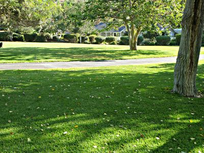 Park-like acres of private lawn in front of the Old Castle Cottage.