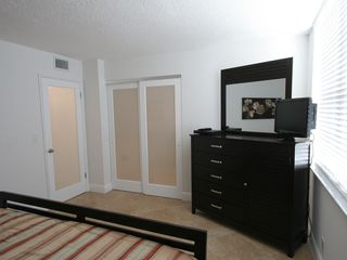 "Delray Beach apartment photo - Dresser with mirror and 24"" flat screen TV with DVD player."