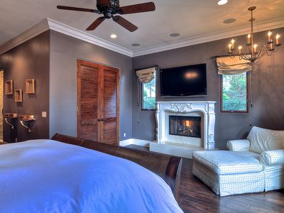 Master bedroom w/ fireplace, flat screen TV