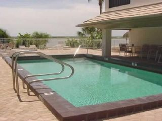 Fort Myers Beach condo photo - Pool - with restrooms and kitchen area off to the side.
