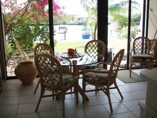 Treasure Cay condo photo - View from kitchen, dining view of patio, dock beyond