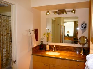 Waikiki condo photo - New maple vanity & granite counter top; pocket door to tub/shower & toilet/bidet
