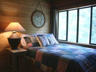 Apalachicola cabin photo - full size bed on the stairs landing. note: this room is open to the living room.