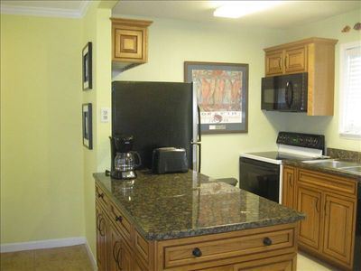 Fully equipped kitchen, granite counter tops, extra cabinet space, ICEMAKER!