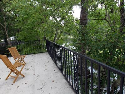 Large upstairs deck over river w/ lounge chairs and hammock