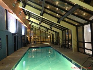 Caravelle Resort condo photo - Indoor pool and hot tubs at night