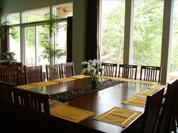Dining Table Seats 14 Comfortably with 5 Extra Seats at nearby Kitchen Island.