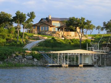 Rear view of Kahala Sunset and private boat dock from Lake Travis