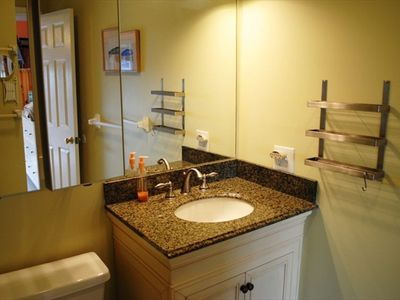 Nicely rennovated master bathroom with granite vanity