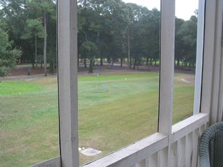 Sunset Beach condo photo - Villa Screened Porch Golf Course View