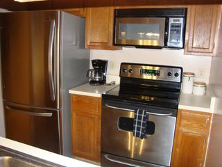 Gainesville condo photo - Our all stainless steel appliance kitchen with bottom freezer refrigerator!