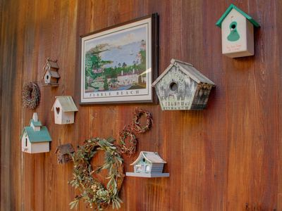 An outdoor wall of whimsical bird houses