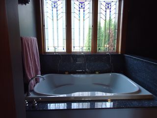 Westport Island house photo - Master bath with 2 person tub and stain glass windows
