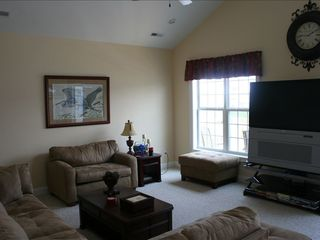 Surfside Beach house photo - Living Room (main floor) with a flat screen TV & Hi def, WIFI, L-shaped sofa.