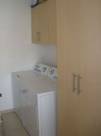 Full- size new washer & dryer in laundry room, adjacent to kitchen