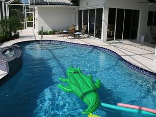 Vacation Homes in Marco Island house photo - Kids love floats in the pool and both kids & adults enjoy sun on chaise lounges
