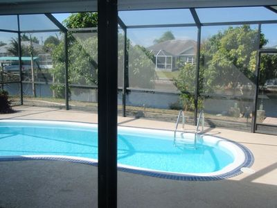 OVERVIEW OF THE POOL AND SCREENED PATIO