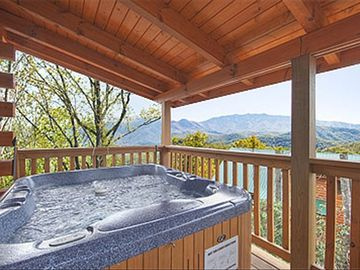 Relax in the private hot tub with breathtaking views both day and night!