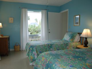 Treasure Cay villa photo - Guest Bedroom 1 full sized bed, 1 twin sized bed, patio, and private bath