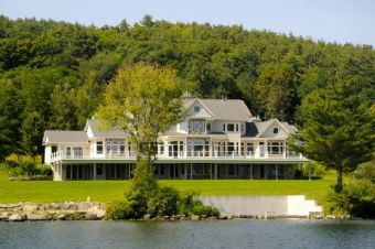 Lake Winnipesaukee, Center Harbor (548) -- Prestigious waterfront estate on 2.5 acres with 350 ft. of beautiful Winnipesaukee water frontage. Amazing lake views with expansive windows in this 10,000+ square foot home.
