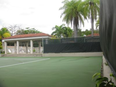 Tennis courts next door to villa