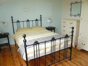Comfortable bedroom with beautiful cast iron bed