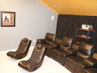 Milam lodge photo - Theatre has 120 inch screen, Theatre Seating, and Surround Sound.