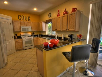 Cooking will never be a chore in this spacious kitchen with granite tops