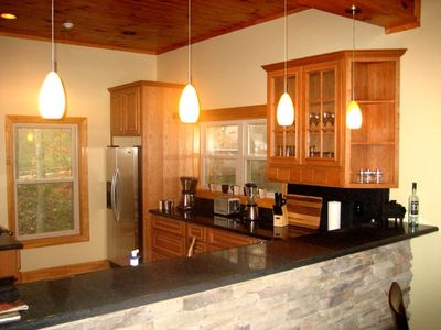 Kitchen features granite countertops, Kitchenaide Architect Pro Appliances