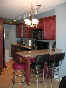 Kitchen with dining island