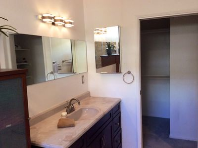 The en-suite master bathroom also features a large walk-in closet.