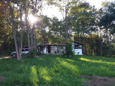 House in the woods, surrounded by the Rio Grande and stunning view of the sunset.