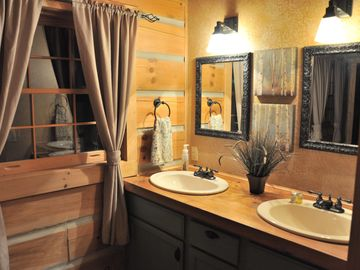 The Master Bathroom Downstairs. Double Sinks, Walk In Open Shower.