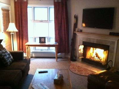 Living room with wood burning fireplace and 46' Flatscreen.......