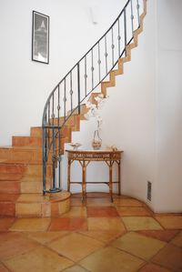 Come inside! Entry Foyer with Sautillo Tiled Winding Staircase.
