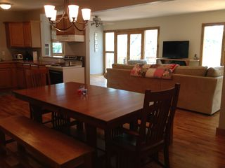 Kitchen & spacious dining table. No dishwasher. Fire extinguisher on wall.