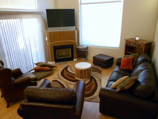 Moab townhome photo - The living room opens out to the patio area. Lots of cozy seating for relaxing.