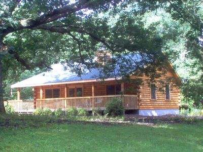Log cabin under 300 year old oak tree, available all year
