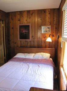 Right Bedroom has a queen-size bed. Can sleep 2. Adjacent Bathroom with Bureau.