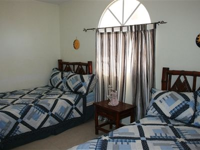 Second bedroom with two double beds