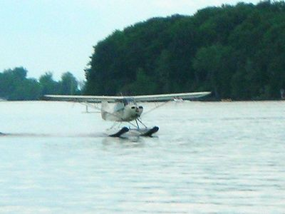 Sea Plane passes by the shoreline. Rides available close by!