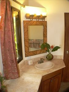Imported coral counter tops in second master bath