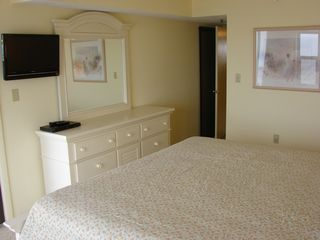 Vacation Homes in Ocean City condo photo - Master Bedroom with new HD wall mount and double dresser